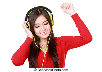 Pretty young girl enjoys listening music Isolated white...