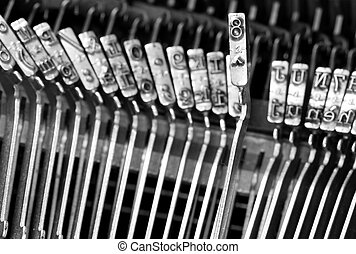 steel hammers for writing with an ancient manual typewriter...
