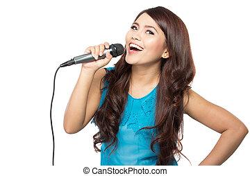 woman singing karaoke - beautiful stylish woman singing...