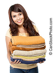 woman with laundry - woman doing a housework holding laundry...