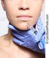 Modeling mouth, aesthetic medicine - The face of a beautiful...