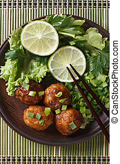 fish balls in curry sauce with lime top view vertical - fish...
