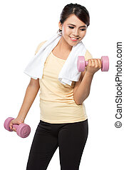 woman exercising with dumbbells - portrait of pretty young...