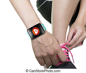 woman hand tying shoelaces wearing bright blue watchband...