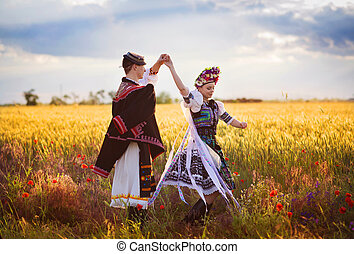 Love couple is dancing in the field - Love couple in sunset...
