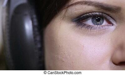 Girl with headphones CU - Girl in big headphones enjoying...
