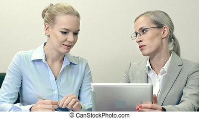 Women in Business - Waist up shot of two attractive...