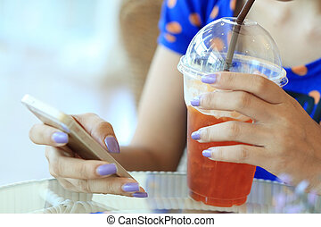 woman using a smart phone in cafe