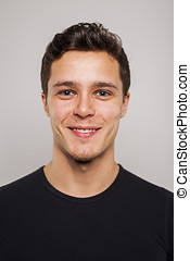 Portrait of young man in black shirt