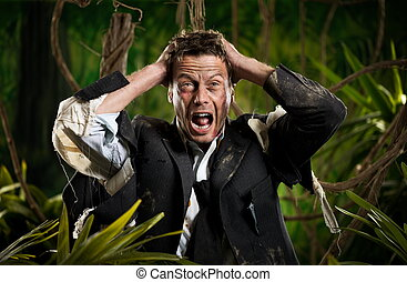 Lost in business jungle - Desperate businessman with head in...