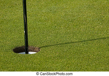18th hole - hole and flag on a golfing green