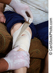 First aid - Doctor doing a bandage for patient. First aid