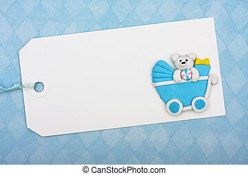 Baby Shower Present - A blank gift tag sitting on blue...