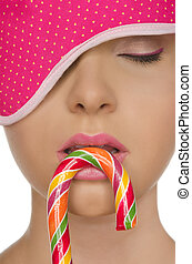 young woman with candy and blindfold - Beautiful young woman...