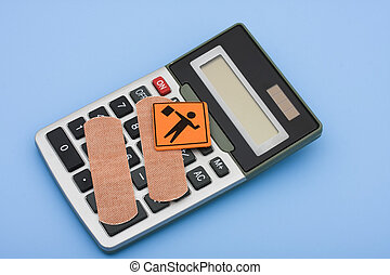 Caution on Healthcare Costs - A calculator with bandage and...