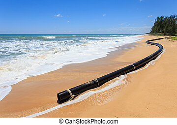BIg drain pipe on the beach
