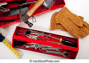 A Red Toolbox with miscellaneous tools - A handyman\'s tool...