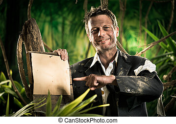 Survivor businessman pointing at sign - Confident smiling...