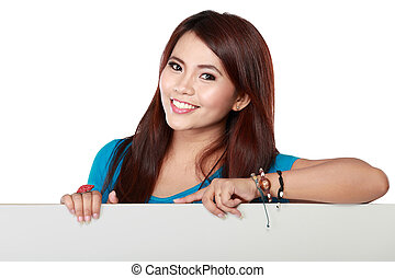 Happy smiling young business woman showing blank paper -...