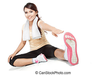 fitness woman warming up - healthy fitness woman stretching...