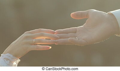 Newlyweds fingers gently touch each other - Close up of...