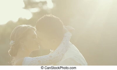 Young newlyweds kissing each other with love and tenderness