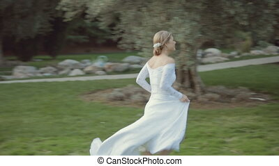 Wonderful bride runs to the groom and he circling her in the...