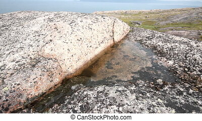 fresh water in rock among salty ocean - reserve of fresh...