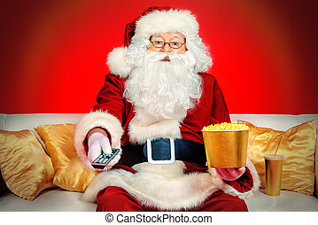 popcorn - Traditional Santa Claus sitting on the couch...