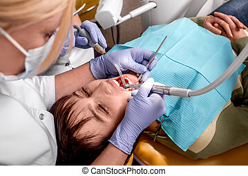 Senior woman on the dental operation. - Senior woman on the...