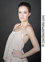 Shot of a Stunning Fashion Brunette on Grey Background
