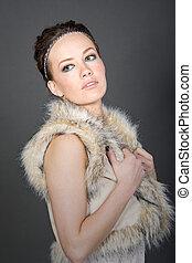 Shot of a Pretty Brunette in Fake Fur Gillet
