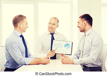 smiling businessmen with papers in office - business and...