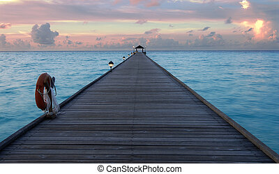 Sunset in the maldives - Beautiful sunset over the jetty in...