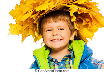 Little happy boy in maple wreath on white - Happy portrait...