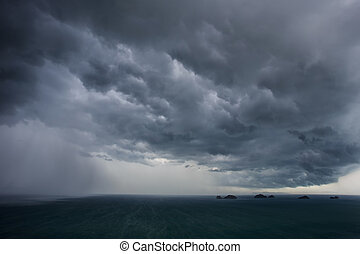 dark clouds before raining over the sea in Thailand