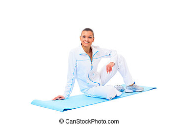 fitness woman making a break in tailor-seat on white background