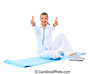fitness woman making a break in tailor-seat on white...