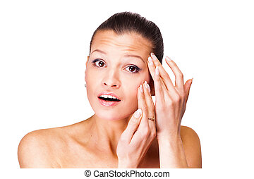 A young woman has problems with the skin Isolated on white...