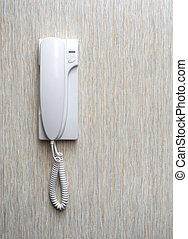 intercom home hung on a wall