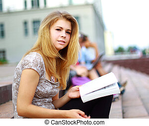 Portrait of a beautiful young female studen