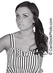 Monochromatic Shot of a Pretty Teenager in Striped Dress