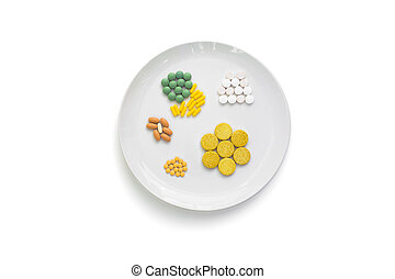 DIETARY SUPPLEMENT 2 - A dish with various drugs on it, that...