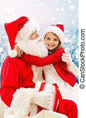 smiling little girl with santa claus and gifts - holidays,...