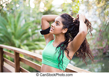 Fitness woman having a break on her exercise
