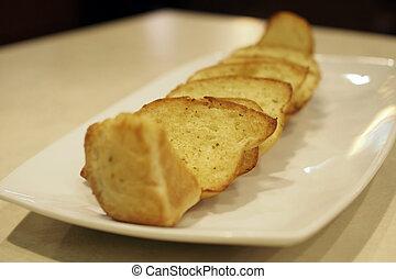 garlic bread - delicious garlic bread in white plate