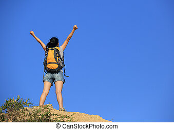 success woman hiker open arms mountain peak