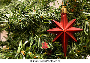 Red star - red star ornament hanging from a christmas tree