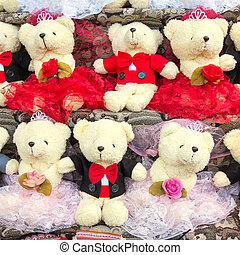 group of teddy bear on shelf in funfair