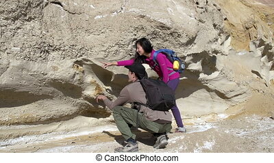 Paleontologists Expedition - Two paleontologist considering...